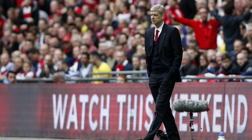 (140413) -- LONDON, April 13, 2014 (Xinhua) -- Arsene Wenger, manager of Arsenal, looks on during FA Cup semifinal match between Arsenal and Wigan Athletic at Wembley Stadium in London, Britain, on April 12, 2014. Arsenal advanced to the final with winning 4-2 on penalties after a 1-1 draw. (Xinhua/Wang Lili)    FOR EDITORIAL USE ONLY. NOT FOR SALE FOR MARKETING OR ADVERTISING CAMPAIGNS. NO USE WITH UNAUTHORIZED AUDIO, VIDEO, DATA, FIXTURE LISTS, CLUBLEAGUE LOGOS OR LIVE SERVICES. ONLINE IN-MATCH USE LIMITED TO 45 IMAGES, NO VIDEO EMULATION. NO USE IN BETTING, GAMES OR SINGLE  CLUBLEAGUEPLAYER PUBLICATIONS.
