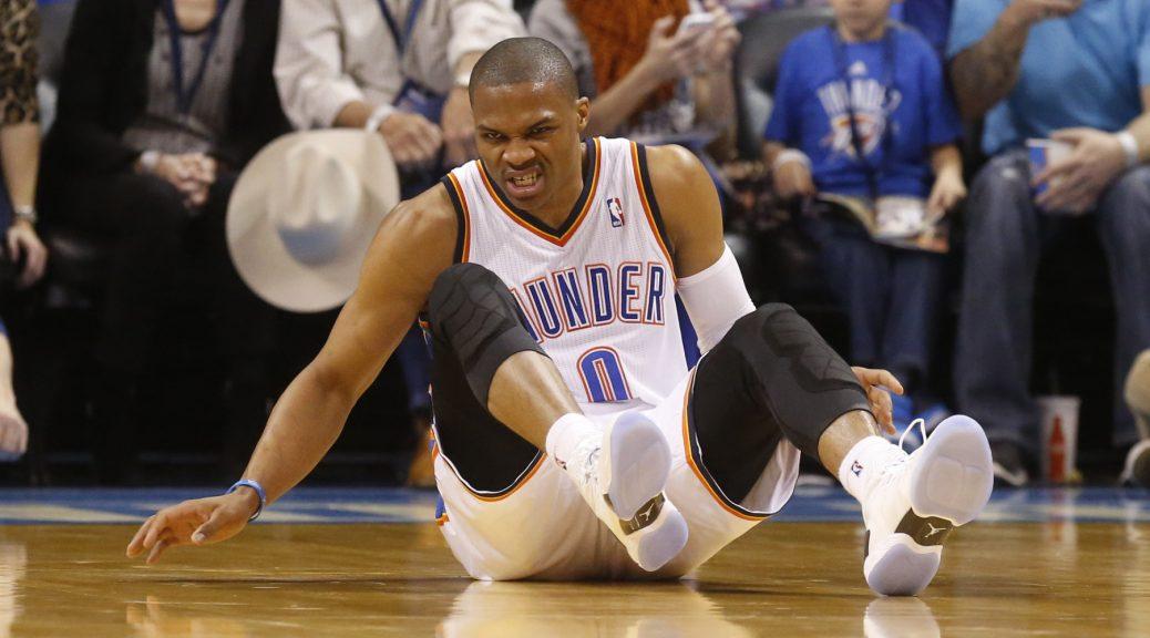 Oklahoma City Thunder guard Russell Westbrook (0) grimaces after falling in the second quarter of an NBA basketball game against the Chicago Bulls in Oklahoma City, Thursday, Dec. 19, 2013. (AP Photo/Sue Ogrocki)