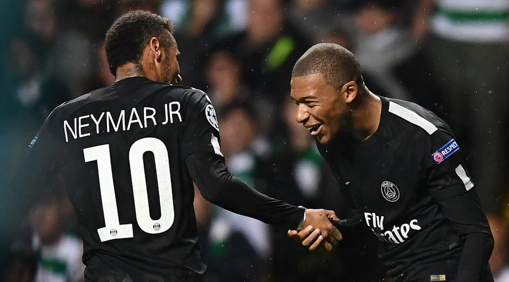 Paris Saint-Germain's French striker Kylian Mbappe (R) celebrates with Paris Saint-Germain's Brazilian striker Neymar after scoring their second goal during the UEFA Champions League Group B football match between Celtic and Paris Saint-Germain (PSG) at Celtic Park in Glasgow, on September 12, 2017. / AFP PHOTO / FRANCK FIFE