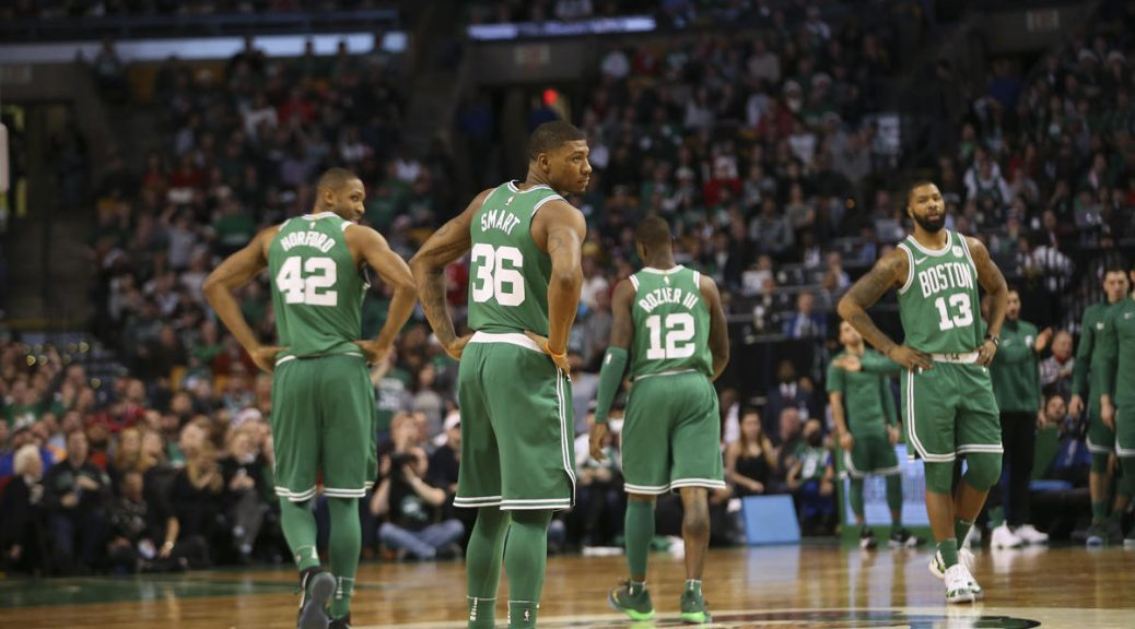 (Boston, MA 12/25/17) The Boston Celtics team members walk down the court in the third quarter as the Boston Celtics take on the Washington Wizards at the TD Garden in Boston on Monday, December 25, 2017. Staff photo by Nicolaus Czarnecki